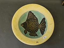 A plaster dish with incised and painted decoration of an angel fish, 18½''