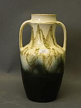 A Continental twin handled pottery vase, 16'' high