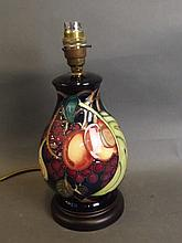 A Moorcroft porcelain table lamp with peach and grape decoration, 11'' high