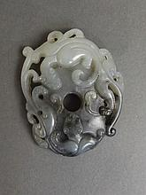 A Chinese carved and pierced marbled grey jade pendant with twin kylin deco