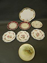 A collection of hand painted cabinet plates including a Doulton plate decor
