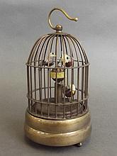 A cased brass automaton birdcage clock, 6½'' high