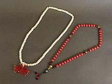 A coral bead necklace with gilt and turquoise feature beads, and a bone nec