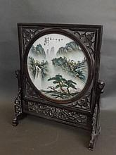 A Chinese carved and pierced hardwood revolving table screen with a circula