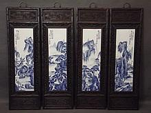 A set of four Chinese porcelain plaques with decoration in the blue and whi