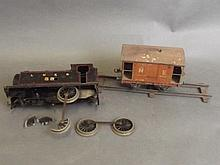 A Bassett-Lowke tinplate clockwork locomotive and wagon, 7'' long (AF)