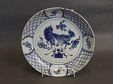 A late C18th/early C19th Chinese blue and white porcelain dish with painted