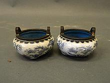 A pair of Chinese twin handled bronze censers with blue and white enamel de