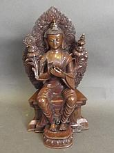 A Tibetan bronze figure of Buddha seated, 12'' high
