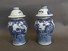 A pair of Chinese blue and white vases and covers decorated with figures st