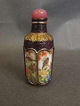 A Peking glass snuff bottle with four decorative panels painted in enamels