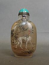 A Chinese glass snuff bottle with reverse painted decoration of dogs, 3¾''
