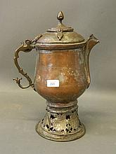An Eastern copper teapot with liner, remains of silver plate, 15'' high