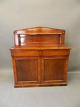 A Victorian mahogany chiffoniere with two drawers over two cupboards and sh