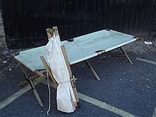 A white canvas camp bed and another in faded green, c1940, 75'' x 32'', 18'