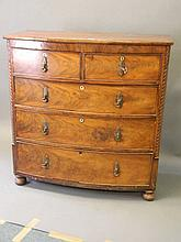 A C19th mahogany bow fronted chest of two and three drawers, with carved ca