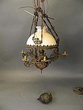 An early C20th Dutch repoussé metal ceiling oil lantern, 34'' long
