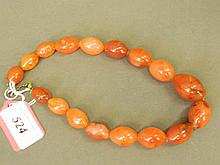 A polished agate bead necklace, 14'' long
