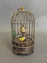 A brass cased automaton bird cage clock, 5'' high