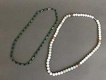 A jade bead necklace, and another, longest 21''