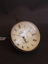 A large brass bound glass ball desk clock, 3'' diameter