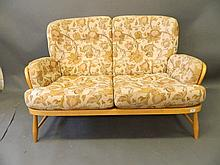 An Ercol beech wood two seater sofa, 54'' wide