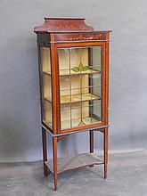 An Edwardian inlaid mahogany display cabinet with lead glass door, on squar