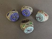 Four white metal and stone set seal rings