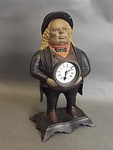 A large painted cast metal automaton clock in the form of a gentleman weari