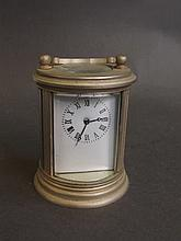 A silver plated cylindrical carriage clock, 2¾'' high