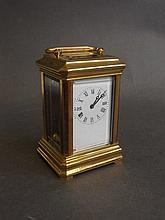 A small brass cased carriage clock, 3'' high