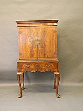A Queen Anne style figured mahogany cocktail cabinet of small proportions,
