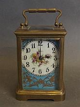 A brass striking carriage clock with blue ground ceramic panels painted wit