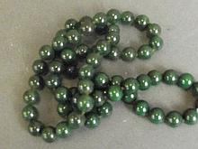 A long string of heavy jade beads, 32'' long