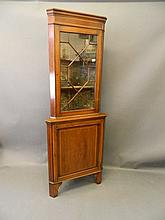 An Edwardian mahogany inlaid two section corner display cabinet, with astra