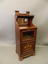 An Art Nouveau inlaid mahogany music cabinet in the style of Liberty, with