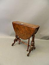 A Victorian burr walnut baby Sutherland oval drop leaf occasional table wit