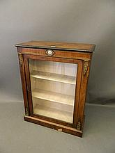 A Victorian inlaid figured walnut pier cabinet with brass mounts and inset
