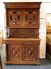A C19th Continental oak dresser, the base with two drawers over cupboards,