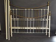 A large brass and cream painted bed frame, 80'' x 72'' x 64''