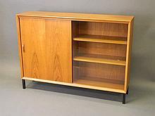 A 1960/70s teak two door bookcase by Gibbs with a glazed door, 48'' x 11'',