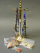 A collection of glass bead necklaces, a quantity of beads, and Mother of Pe