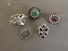 Five silver rings set with semi-precious stones