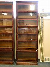 An early C20th mahogany seven section stepped stacking bookcase by Gunn of