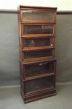 A Globe Wernicke mahogany six section stepped bookcase, 34'' x 86'' x 15''