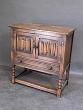 An oak side cabinet with linen fold doors and undertier, 16'' x 31'' x 34''