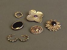 Five Hallmarked silver brooches, and a pair of earrings set with green ston