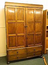 An oak two door cupboard on a four drawer base, 53½'' x 22'', 78½'' high