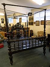 A good Anglo-Indian hardwood four poster bed, the head board with carved an