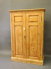 A C19th pine cupboard with two fielded panel doors, on a plinth base, 43''